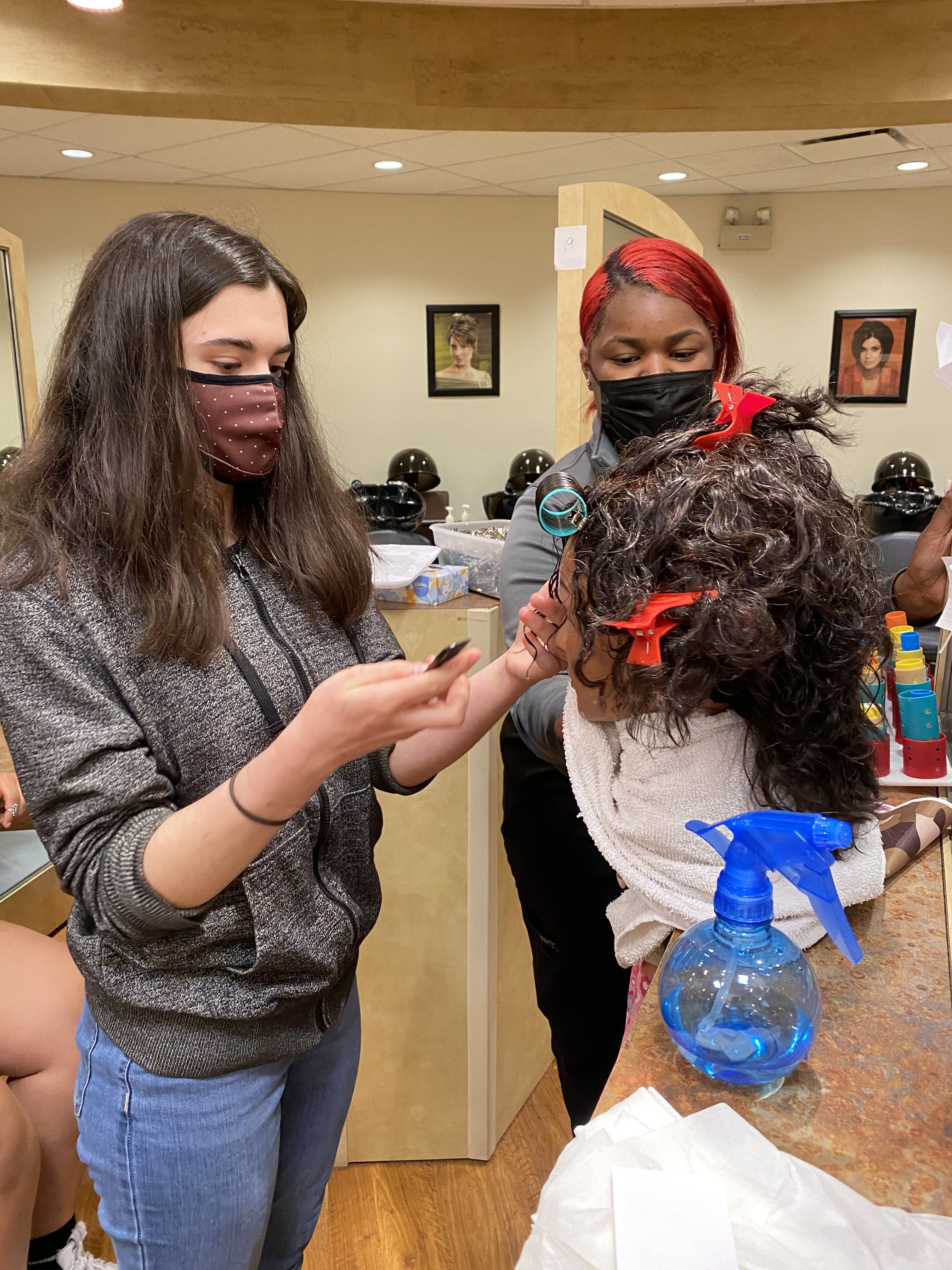 (photo shows a member of the Steel Magnolia cast working with an EFCTS cosmetology student to prepare materials for the upcoming show. credit: Tim Browning)