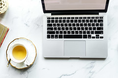 'Aerial view of computer laptop and a+cup+of+tea'
