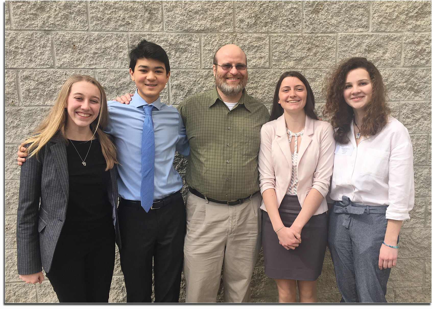 History Day competitors standing with Mr. Fetters.