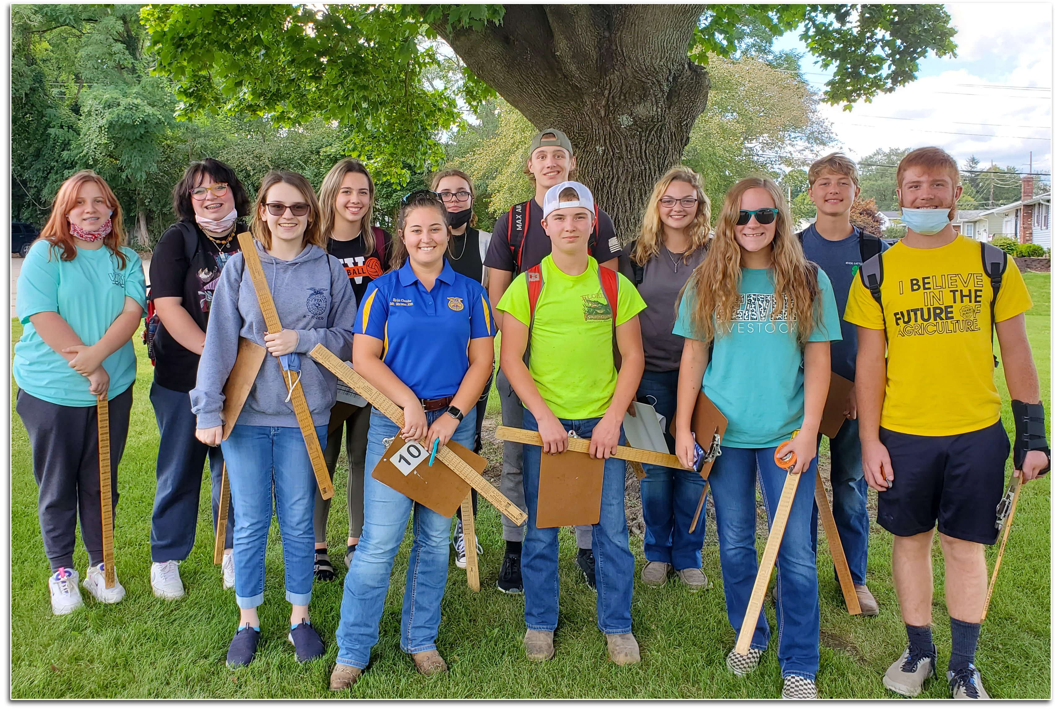 FFA Forestry Team with clipboards and meter sticks.