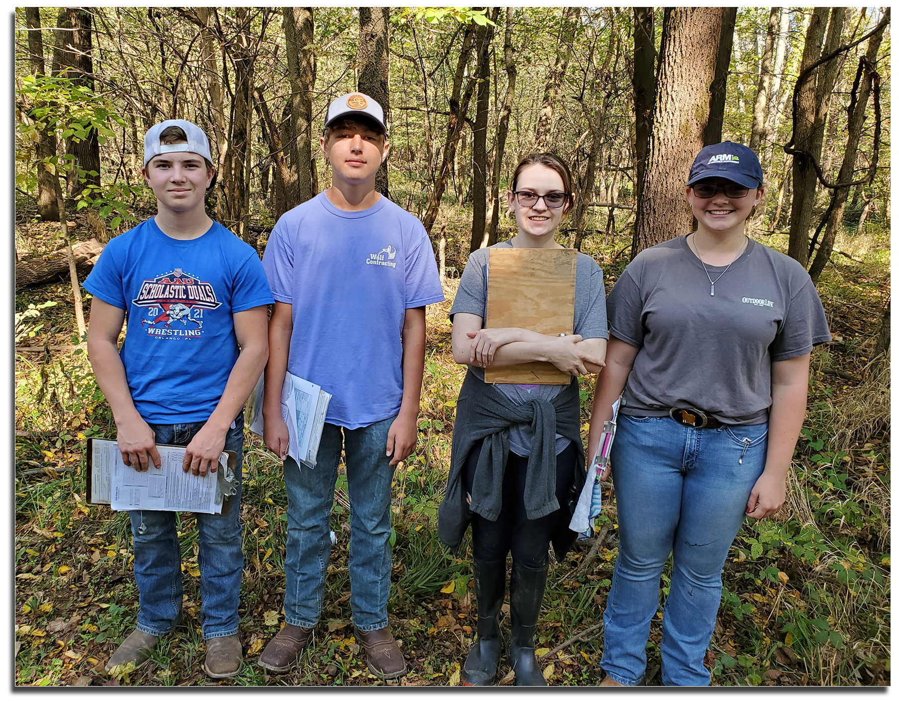 Urban Soils Team standing with clipboards.