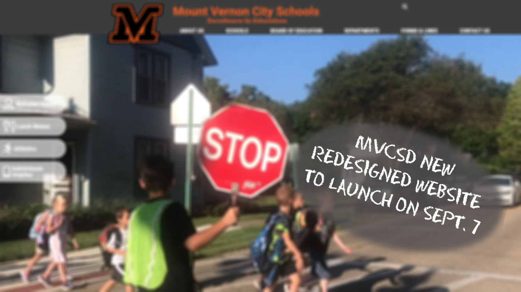 Safety patrol with stop sign and students crossing the street on MVCSDs new website.