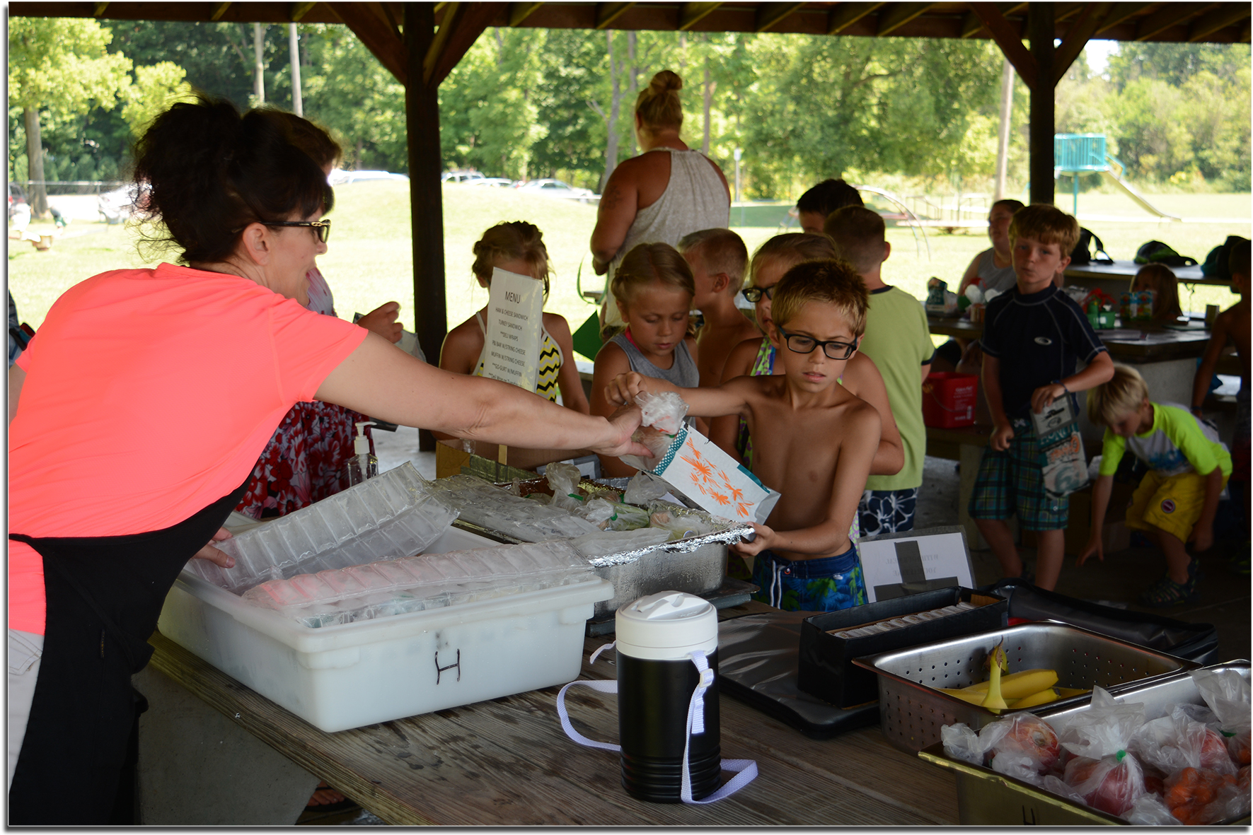 Students receiving their summer lunch at Hiawatha Park.
