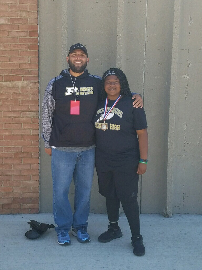 Tajiana Pickett placed 3rd at the OHSAA Jr. High State Track Meet in the shot put. She is pictured with Coach Lorenzo Melchor