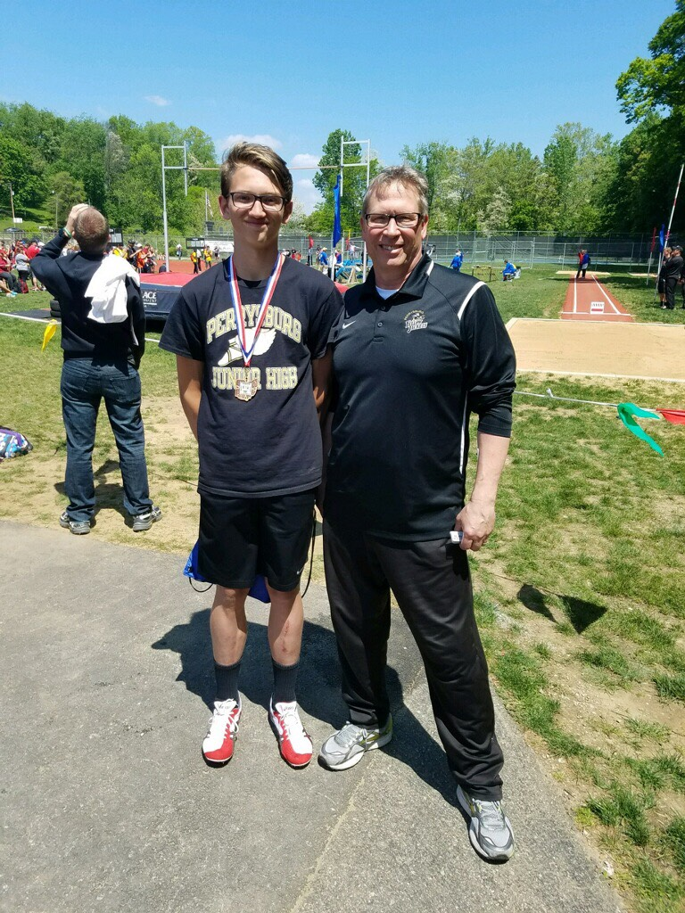 Owen Searfoss placed 4th at the 2017 OHSAA Jr. High State Track meet in the 110 hurdlers. He is pictured with Coach Glenn McIntyre
