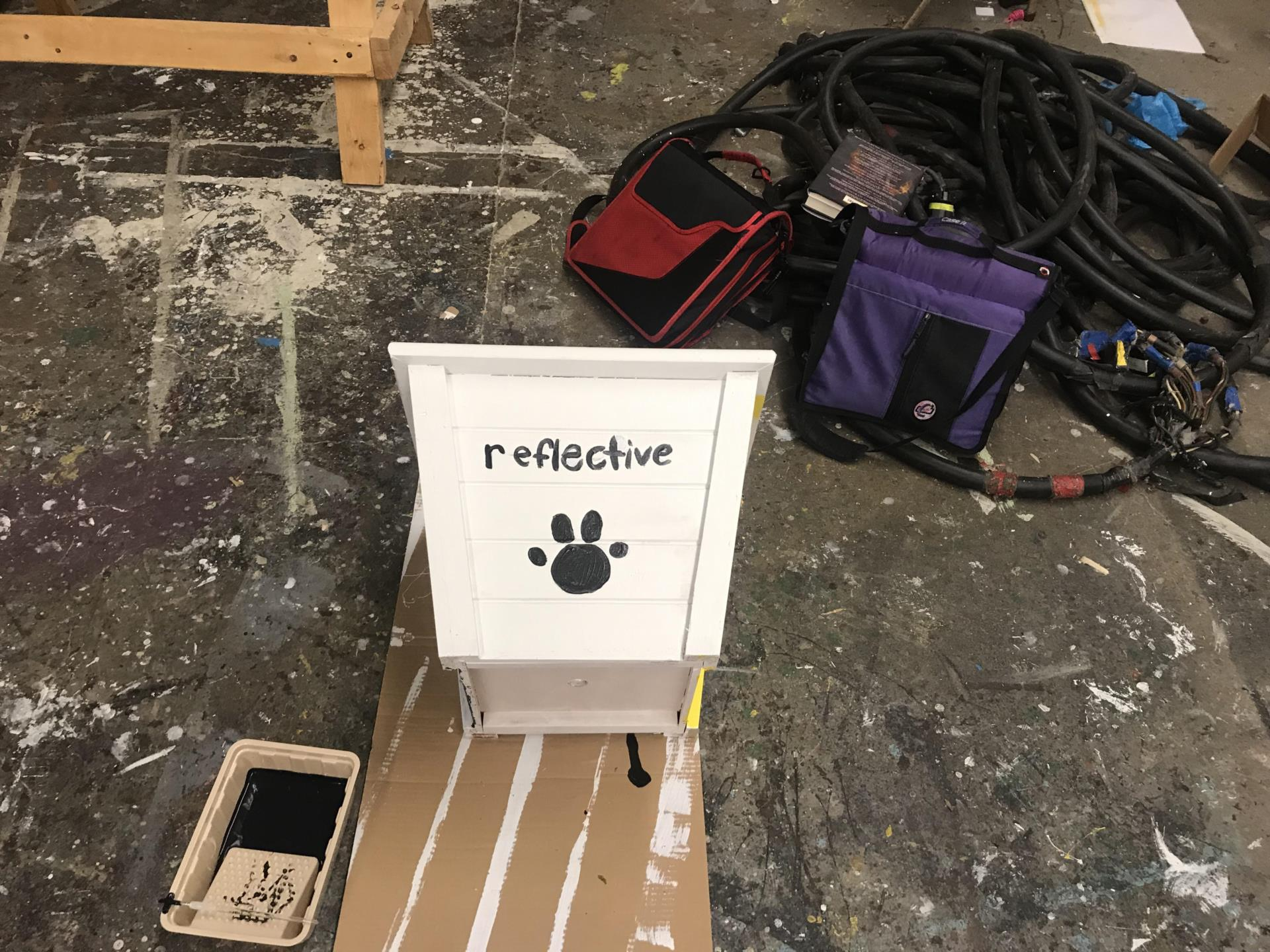flower box with reflective and paw print painted on
