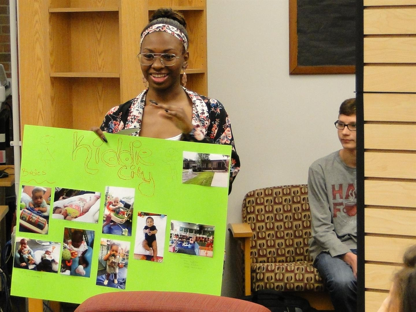 Student with daycare project board