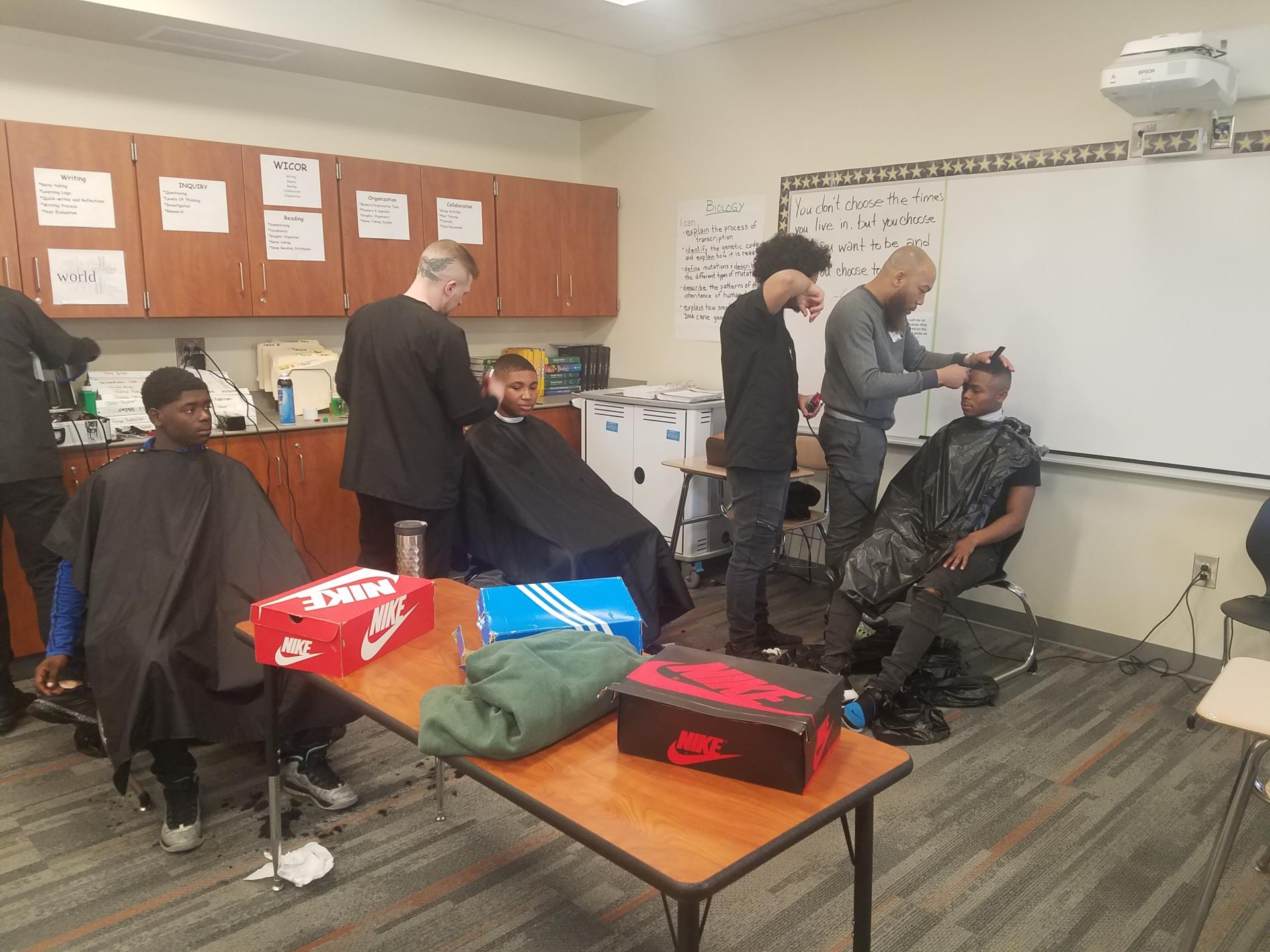 Male students getting haircuts
