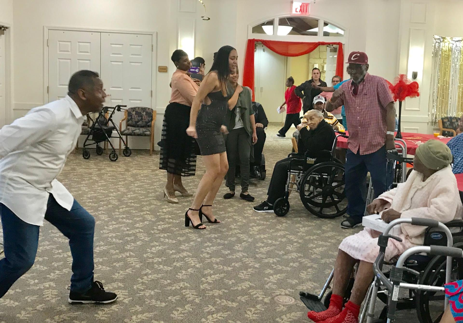 Teens dancing with older adults
