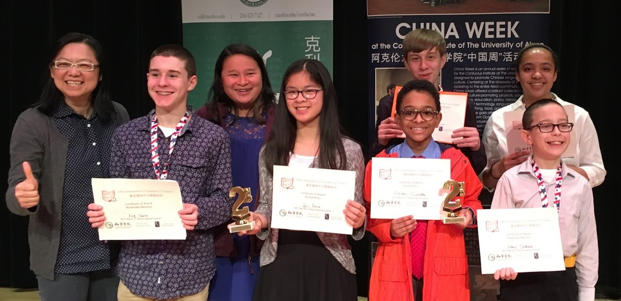Rox Mid Chinese essay and speech winners with teacher