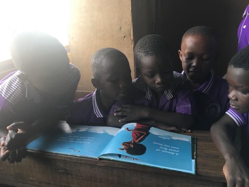 Students in Ghana reading book