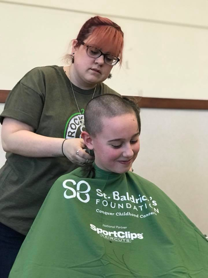 Canterbury 4th grade Sophie Rose Petersal shaves her head for the second year in a row, with the help of Kate League.