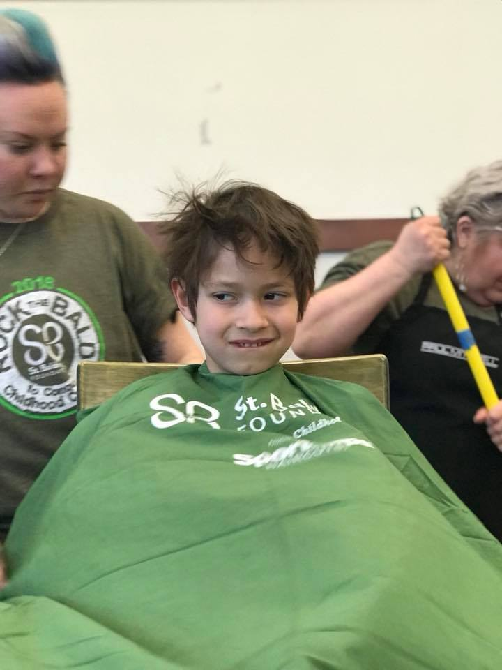 Fairfax 1st grader Joshua Meyer shaves his head in memory of his sister Rebecca