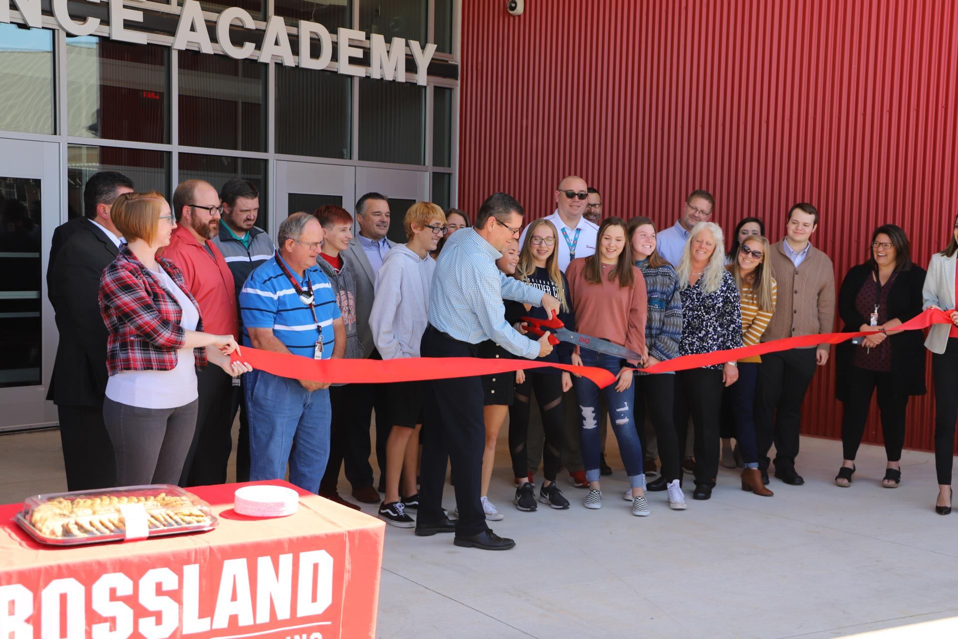 Science Department Chair Tom Garner, backed by students, Science teachers, architects, builders, and MPS administrators, cuts the ribbon of the new 27,385sf Science Academy.