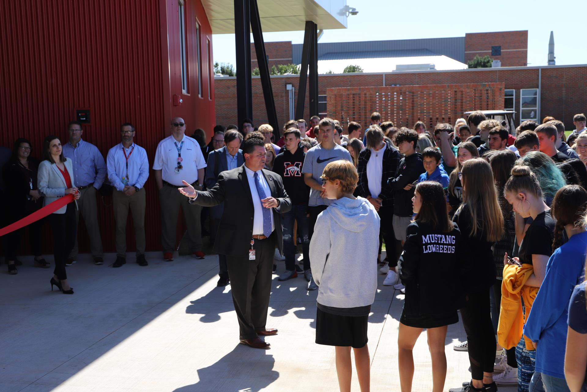 Superintendent Charles Bradley speaks to students at the ribbon-cutting for the new Science Academy.