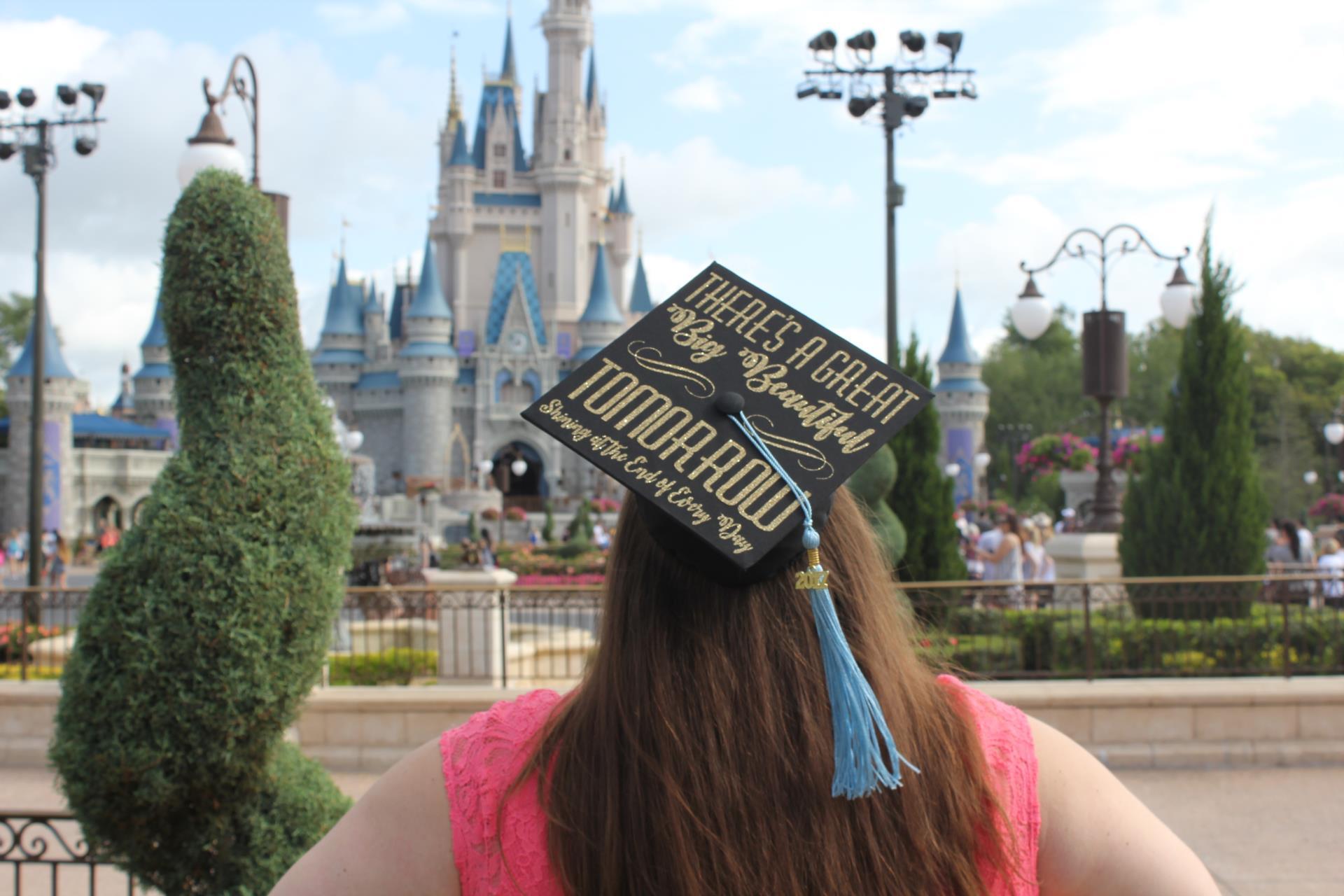 Mrs. Bilsky in Graduation Cap Looking at Disney World Castle