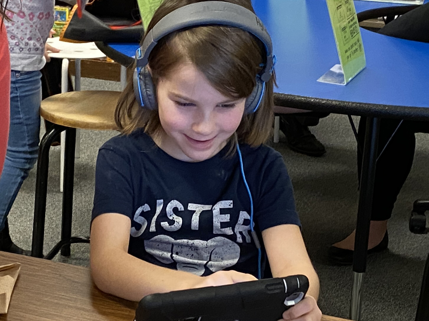 Kindergarten student working on an iPad