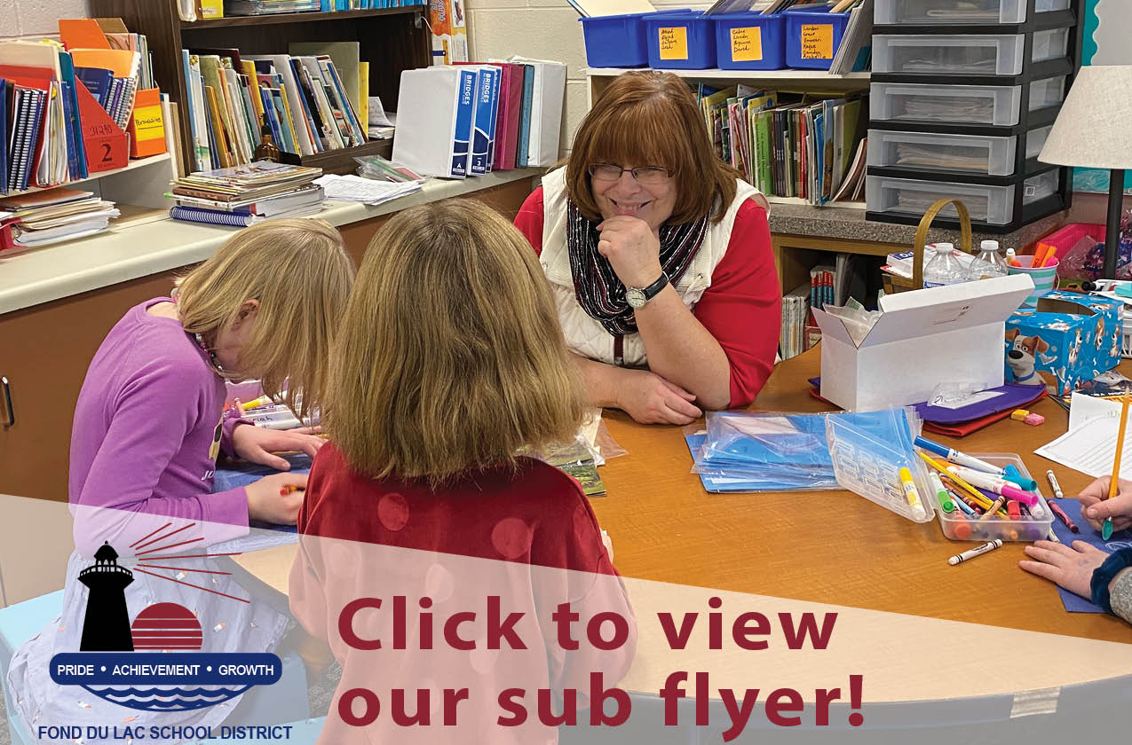 Substitute teacher working with two students