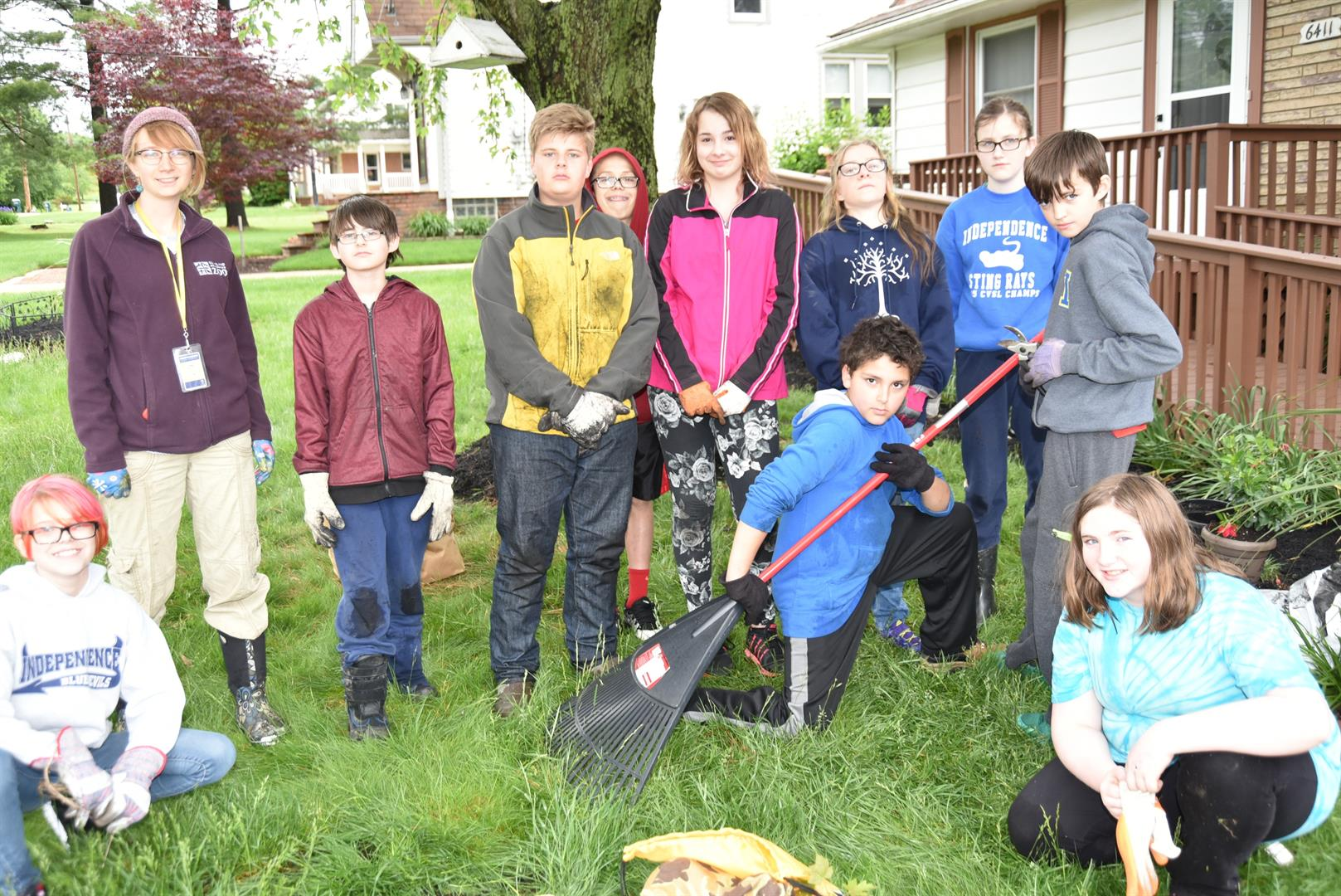 students cleaning yards