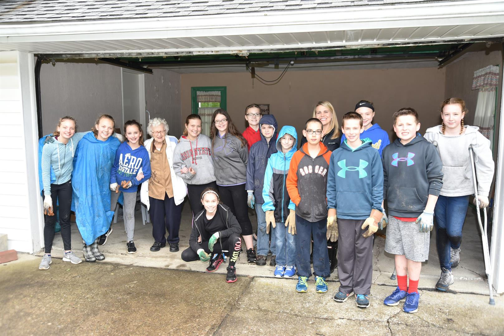 students clean up yards