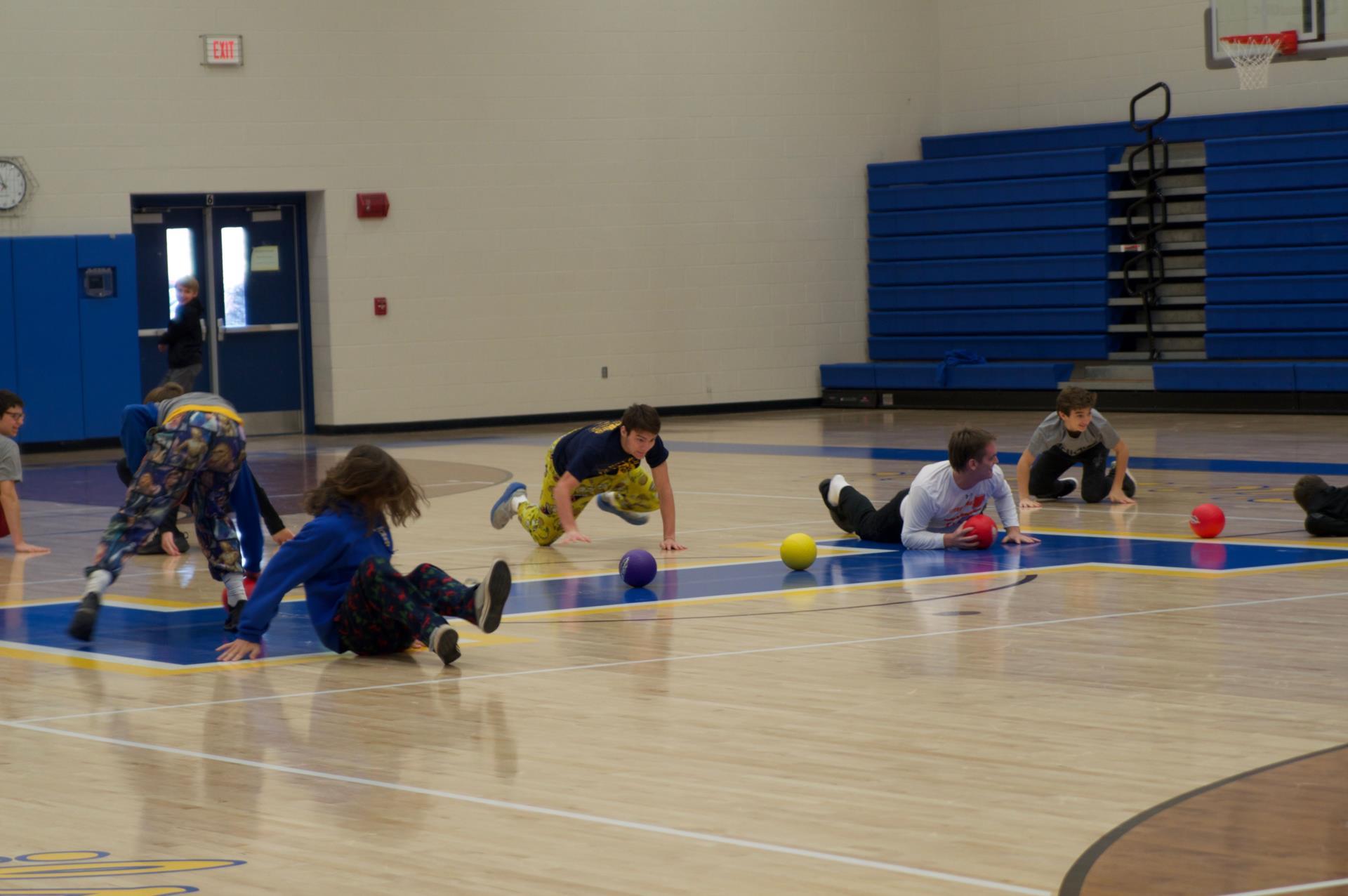 students enjoying battle ball in gym