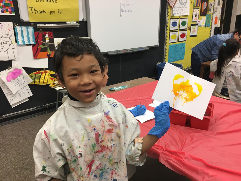 Student painting in Noble's peer to peer program