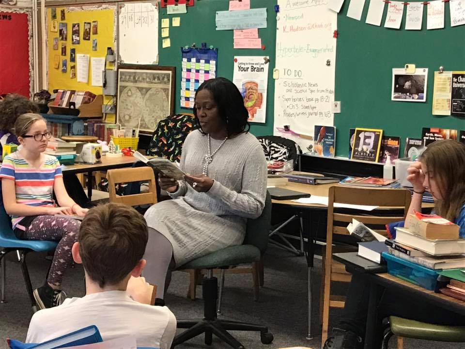 Dr. Talisa Dixon reads to students