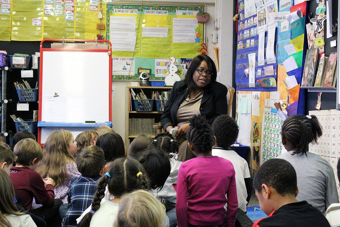 Mayor Cheryl Stephens reads to students