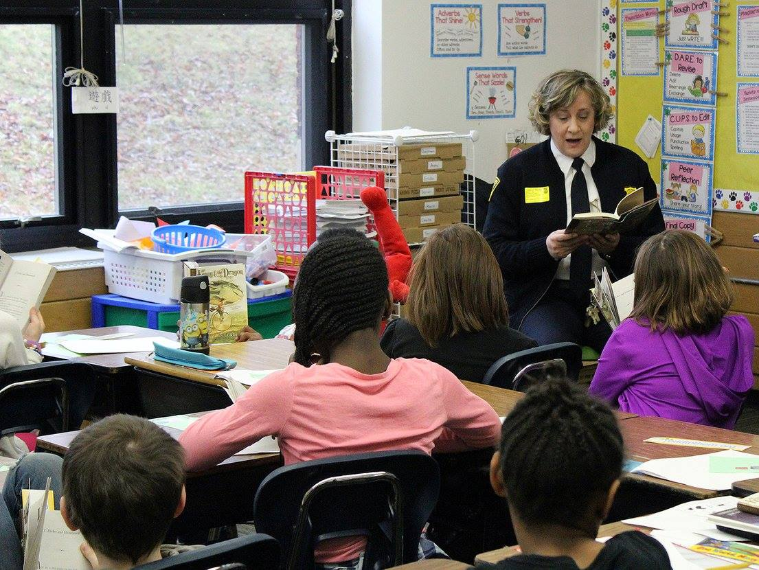 Cleveland Heights Police Chief Annette Mecklenberg reads to a class