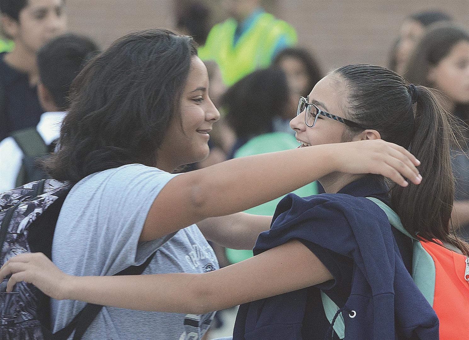 Girls meet first day of school