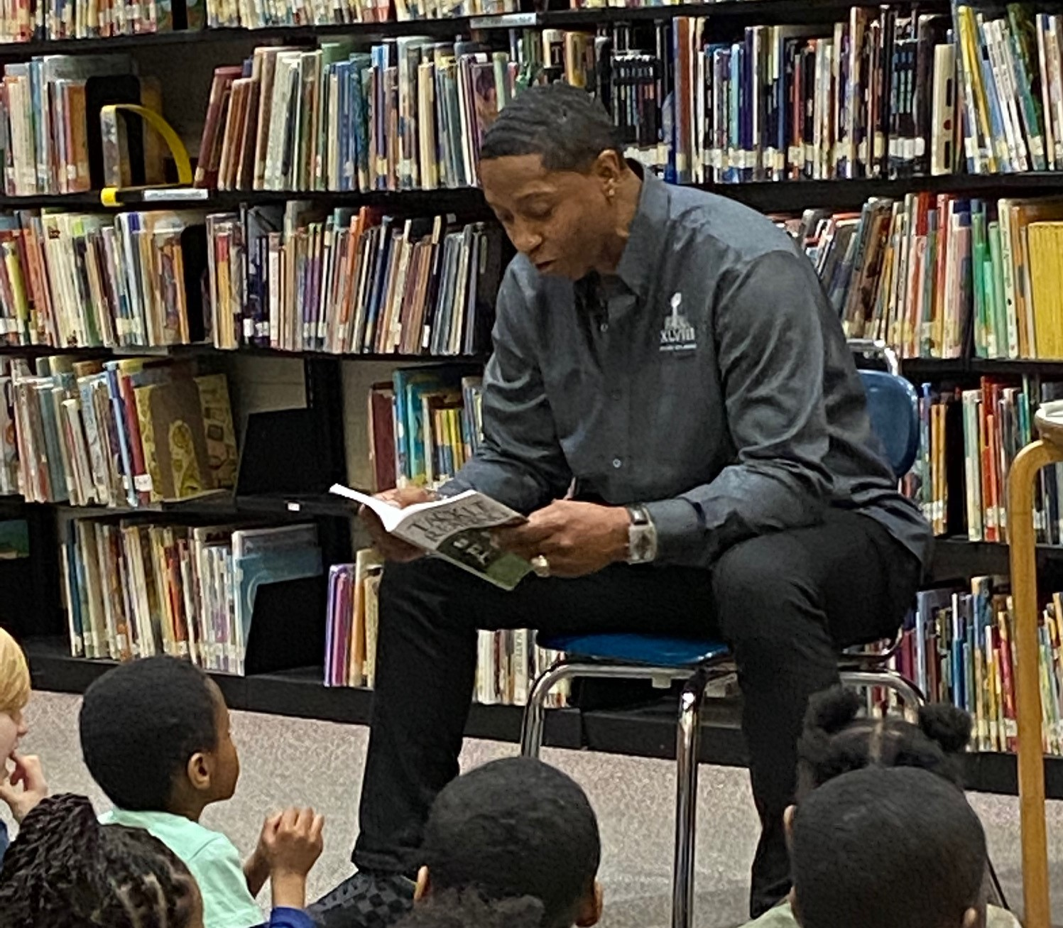 Scooter McGruder Tackles Reading in the Heights Schools