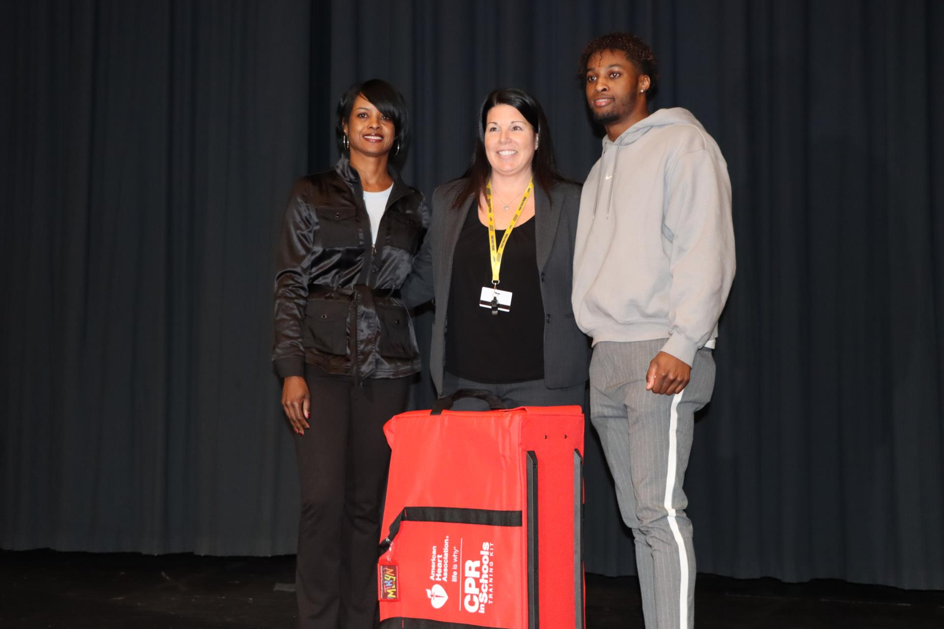 CPR training kit donation to high school