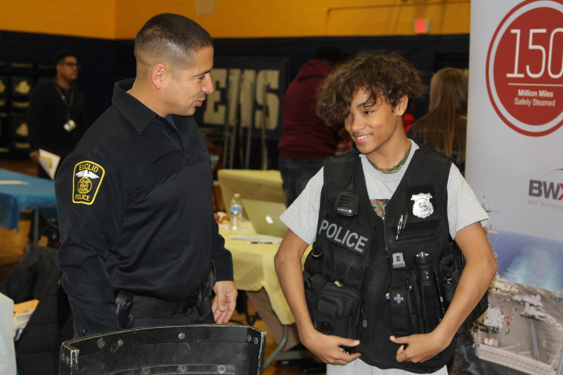 8th grade career fair - police officer and student