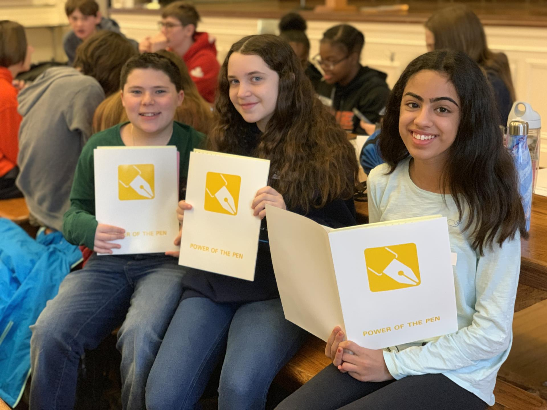 BMS students hold prompts for Power of the Pen Tournament
