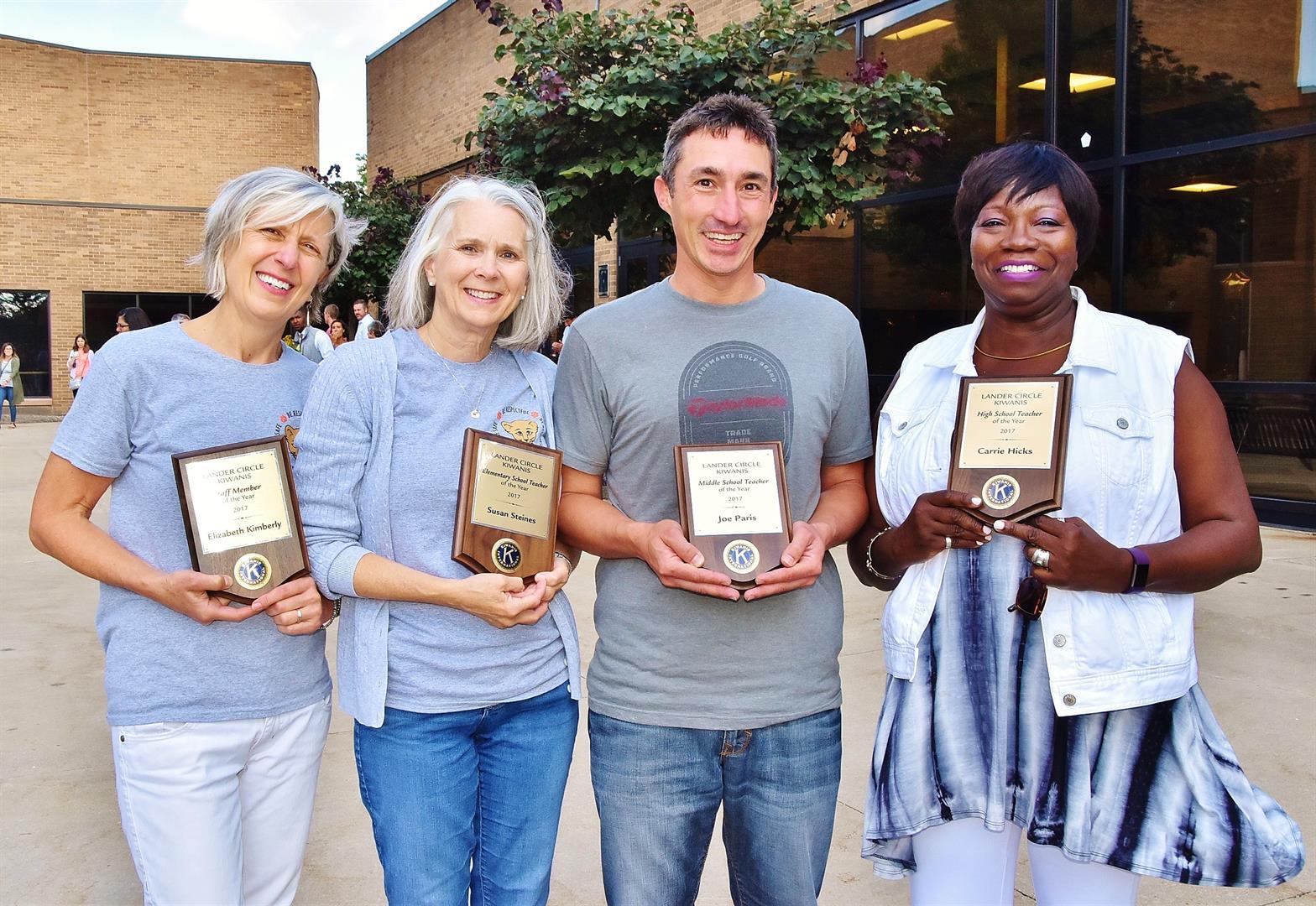 Kiwanis Winners Hold Plaques