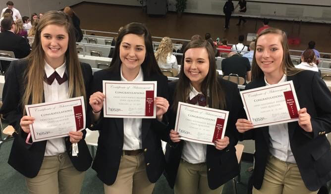 Students holding HOSA certificates