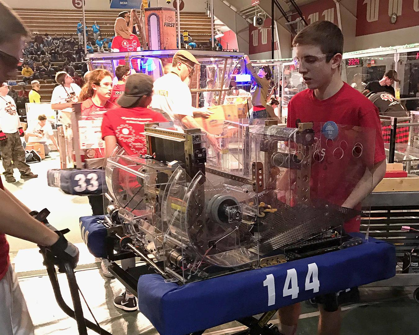 student prepares robot for competition