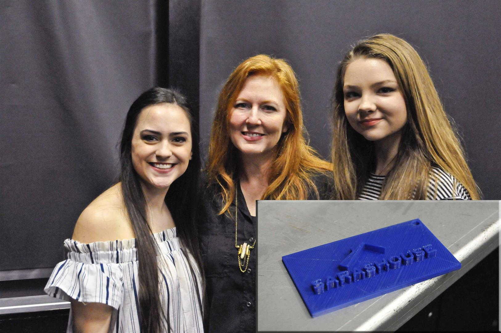 students with owner of Hamilton business