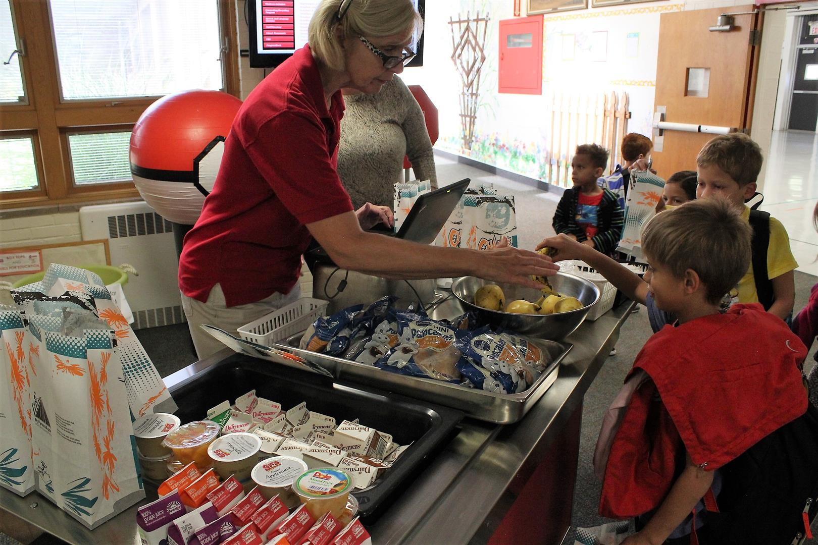 Students purchasing food from the new breakfast cart