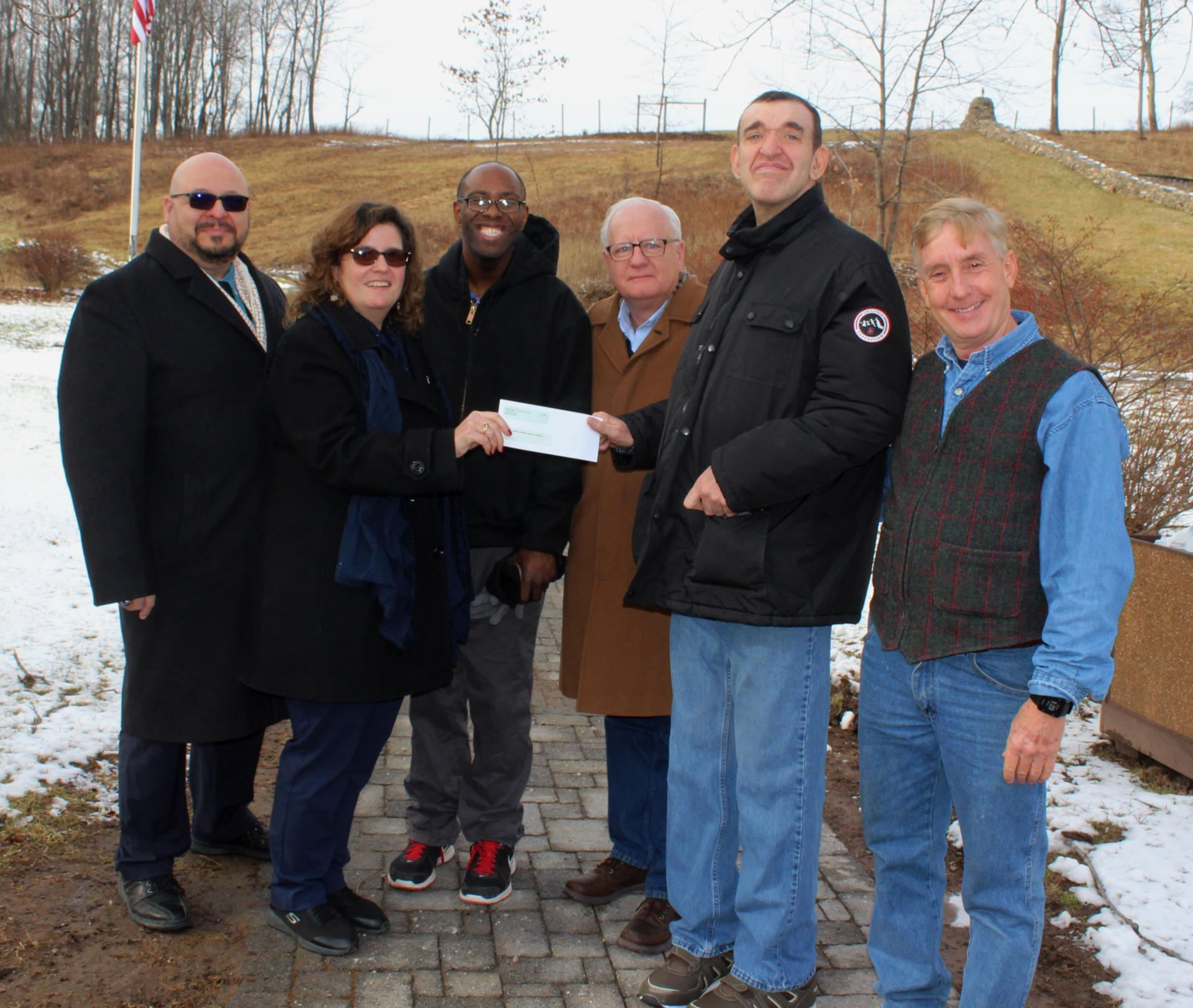 Picture: Cetner of Discovery Presents Check for BCES Hiking Trail
