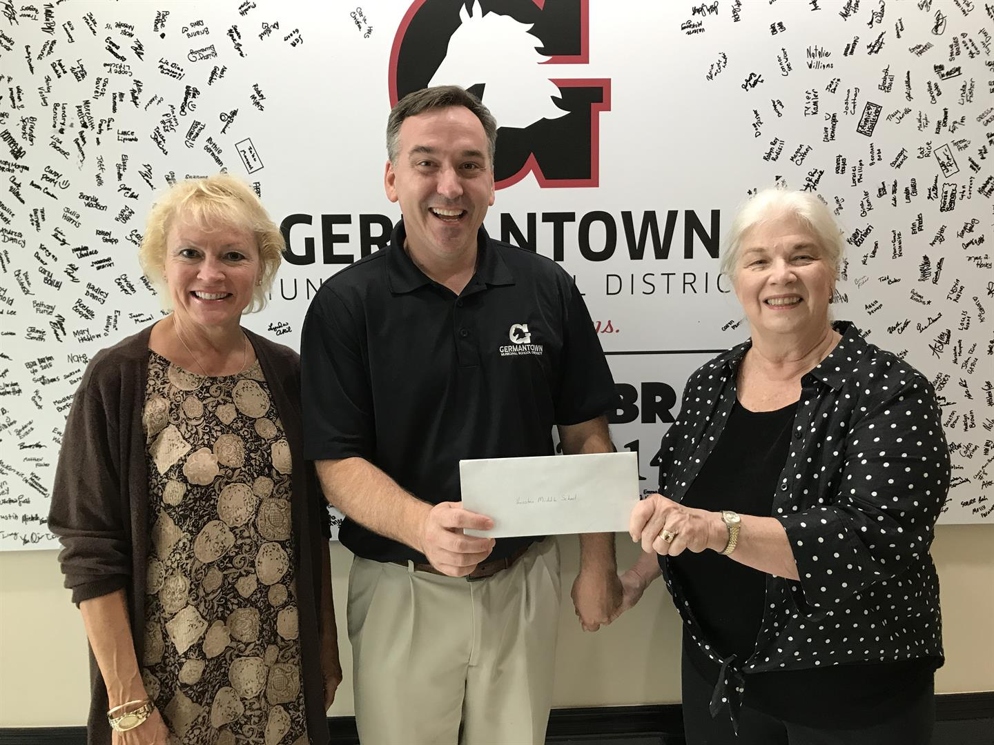 Germantown Women's Club hands a check to the Superintendent.