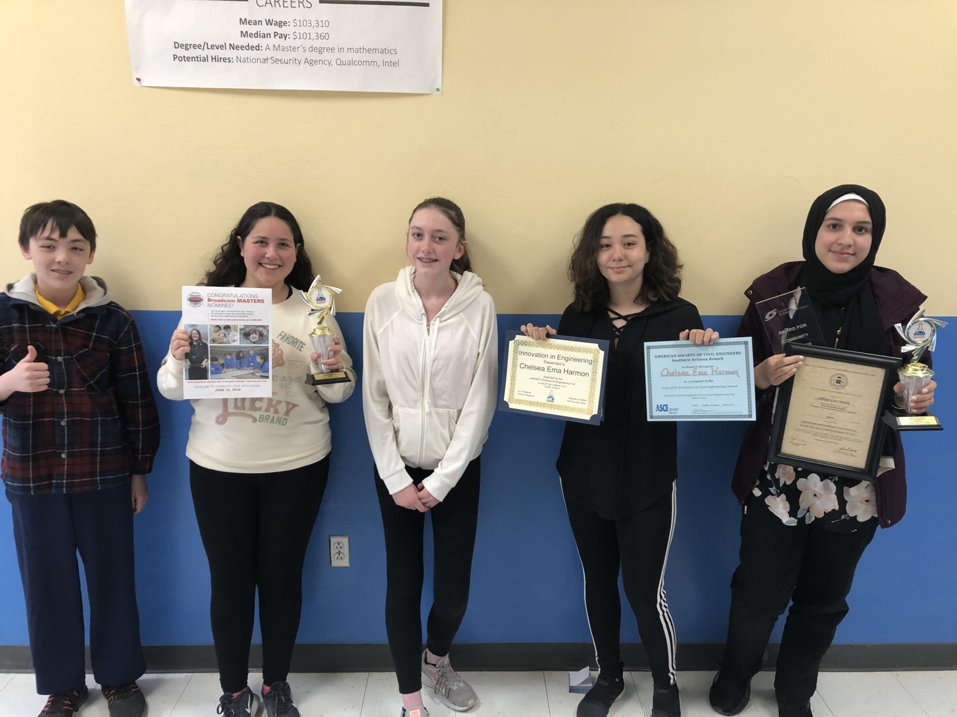 Middle School Students Pose with Awards