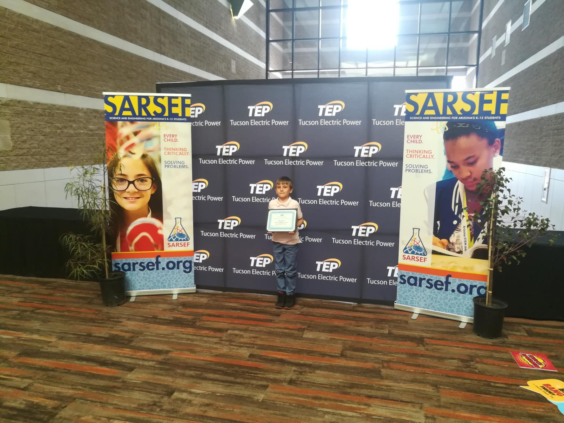 Student poses with science fair award