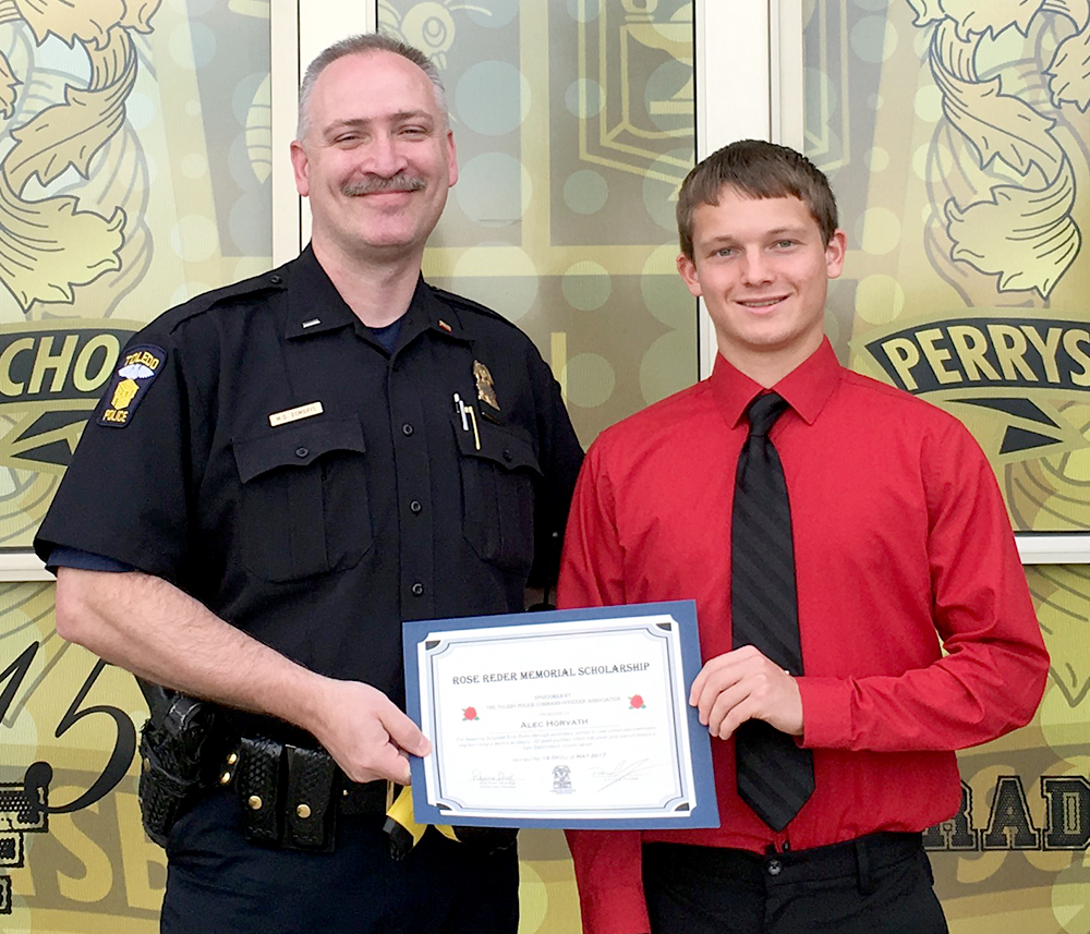Police officer and student holding up scholarship certificate