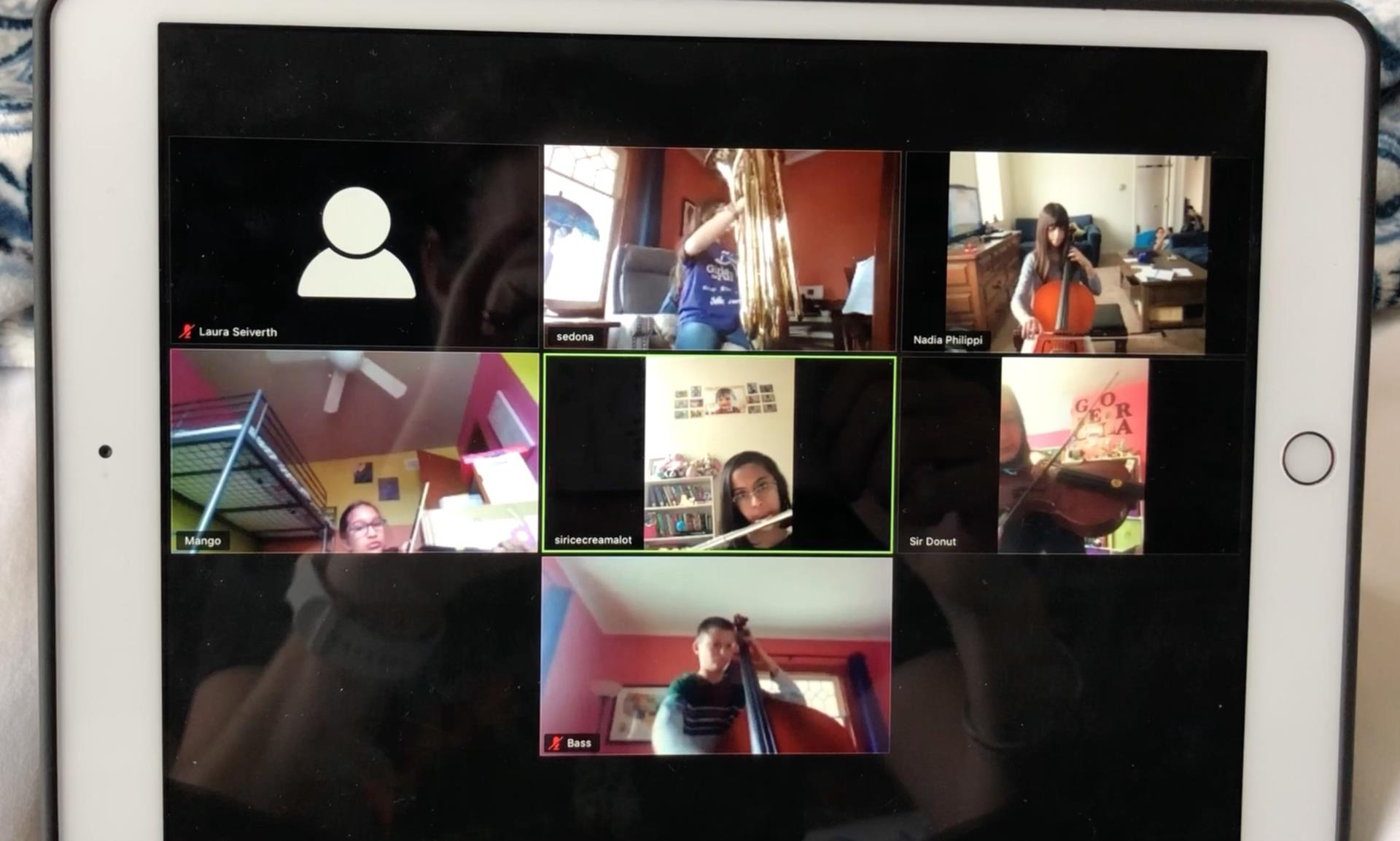 six students in a grid playing instruments
