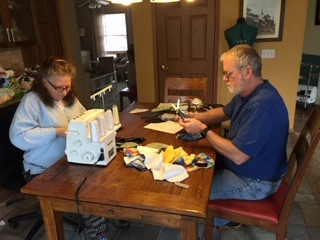 two people working at sewing machine