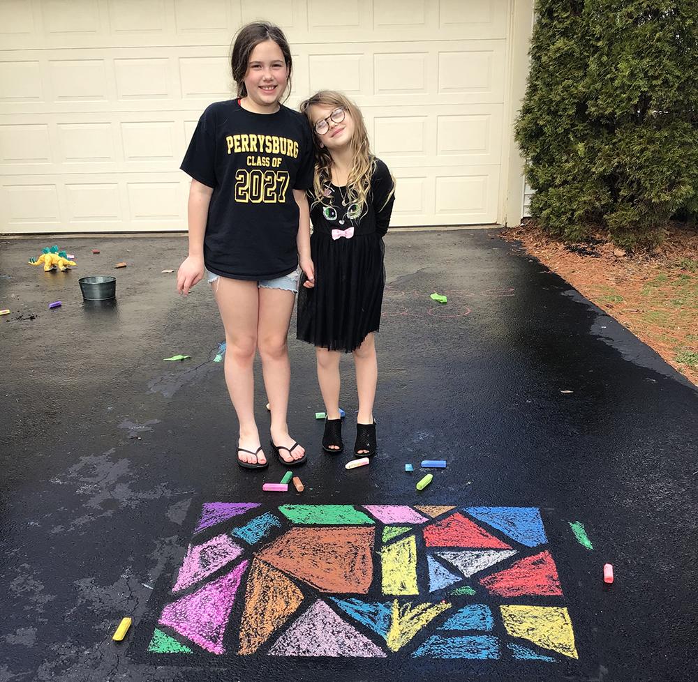 two girls with sidewalk art