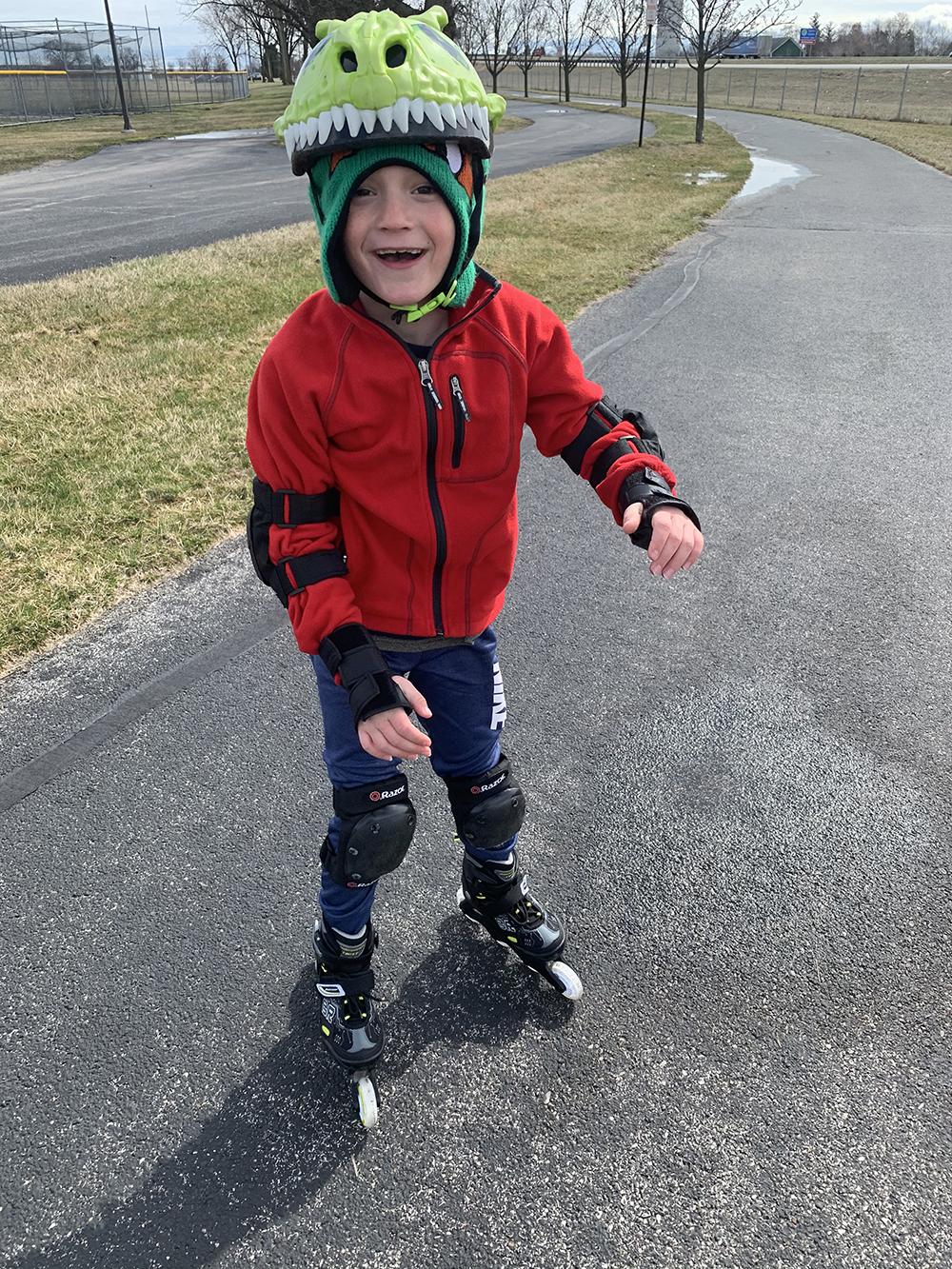 boy in rollerblades