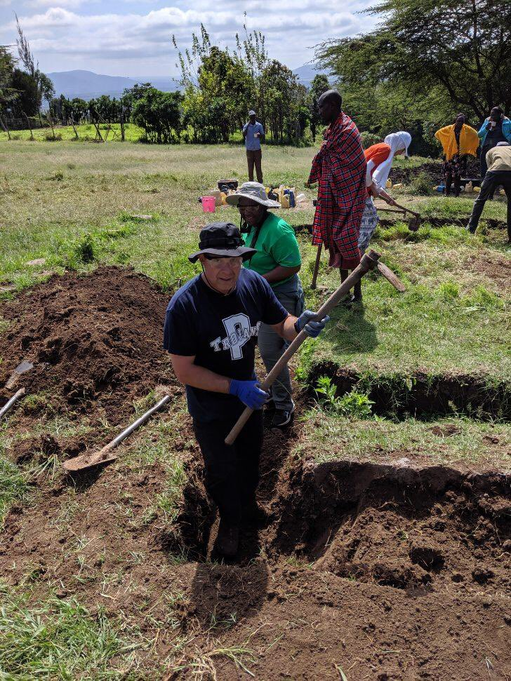 digging in a ditch in Kenya