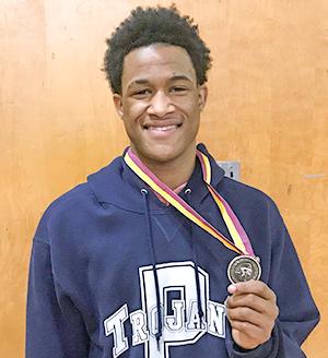 Kylafe holding medal